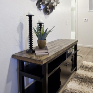 Console table with candlesticks and plant